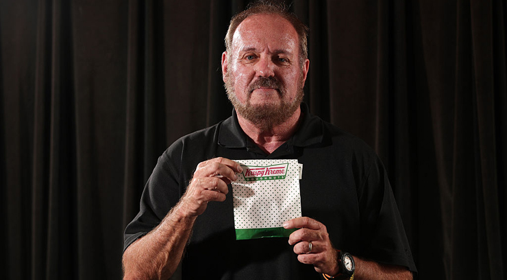 "Daniel Rushing poses with the Krispy Kreme donut he purchases every other Wednesday on Wednesday, July 27, 2016 in Orlando, Fla. Rushing, 64, a retired city employee, had just left a 7-Eleven on West Colonial Drive when an Orlando police officer pulled him over. When she looked inside the car, Officer Shelby Riggs-Hopkins spotted something suspicious on the floorboard - pieces of a ""rock-like"" substance. She conducted a field drug test. The results: methamphetamine. She handcuffed Rushing and took him to jail. It turned out the ""methamphetamine"" were pieces of glaze that had fallen off a Krispie Kreme Doughnut. (Ricardo Ramirez Buxeda/Orlando Sentinel/TNS via Getty Images)"
