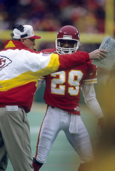 KANSAS CITY, MO - CIRCA 1990's: Head Coach Marty Schottenheimer (L) of the Kansas City Chiefs sending Greg Hill #29 into the game during a mid circa 1990's NFL football game at Arrowhead Stadium in Kansas City, Missouri. Schottenheimer was the head coach of the Kansas City Chiefs from 1989-98. (Photo by Focus on Sport/Getty Images)
