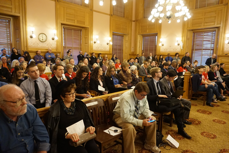 A large crowd was present as each side argued whether guns should be allowed on campus.