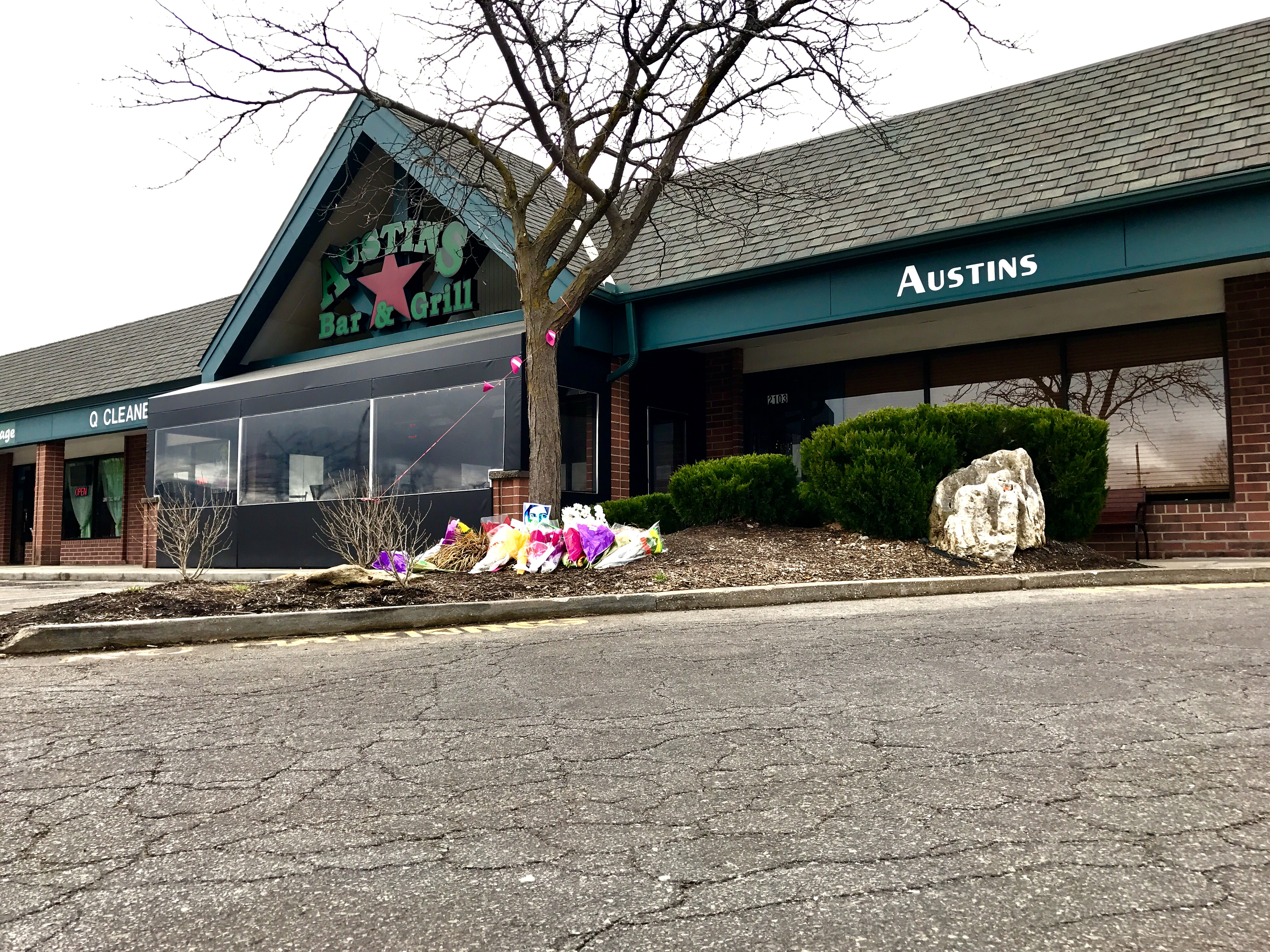 A memorial for the shooting victims was growing outside of Austins Bar and Grill Friday.