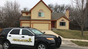 olathe-police-in-front-of-house