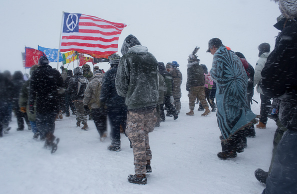 Dec. 5, 2016- On the day of a government order to vacate the area, hundreds of United States military veterans vowed to defend the Standing Rock protest camp. Over two hundred tribes, joined by environmental activists and hundreds of United States military veterans, camp and demonstrate against the Dakota Access Pipeline, which plans to be built under the Missouri River adjacent to the reservation. The gathering has been the largest meeting of Native Americans since the Little Bighorn camp in 1876. (Photo by Andrew Lichtenstein/Corbis via Getty Images)