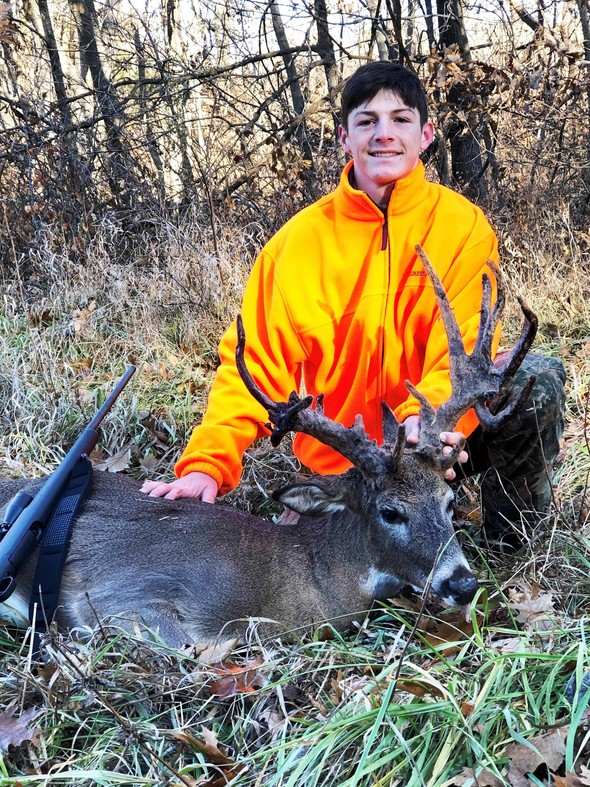 Missouri hunter with antlered female doe picture