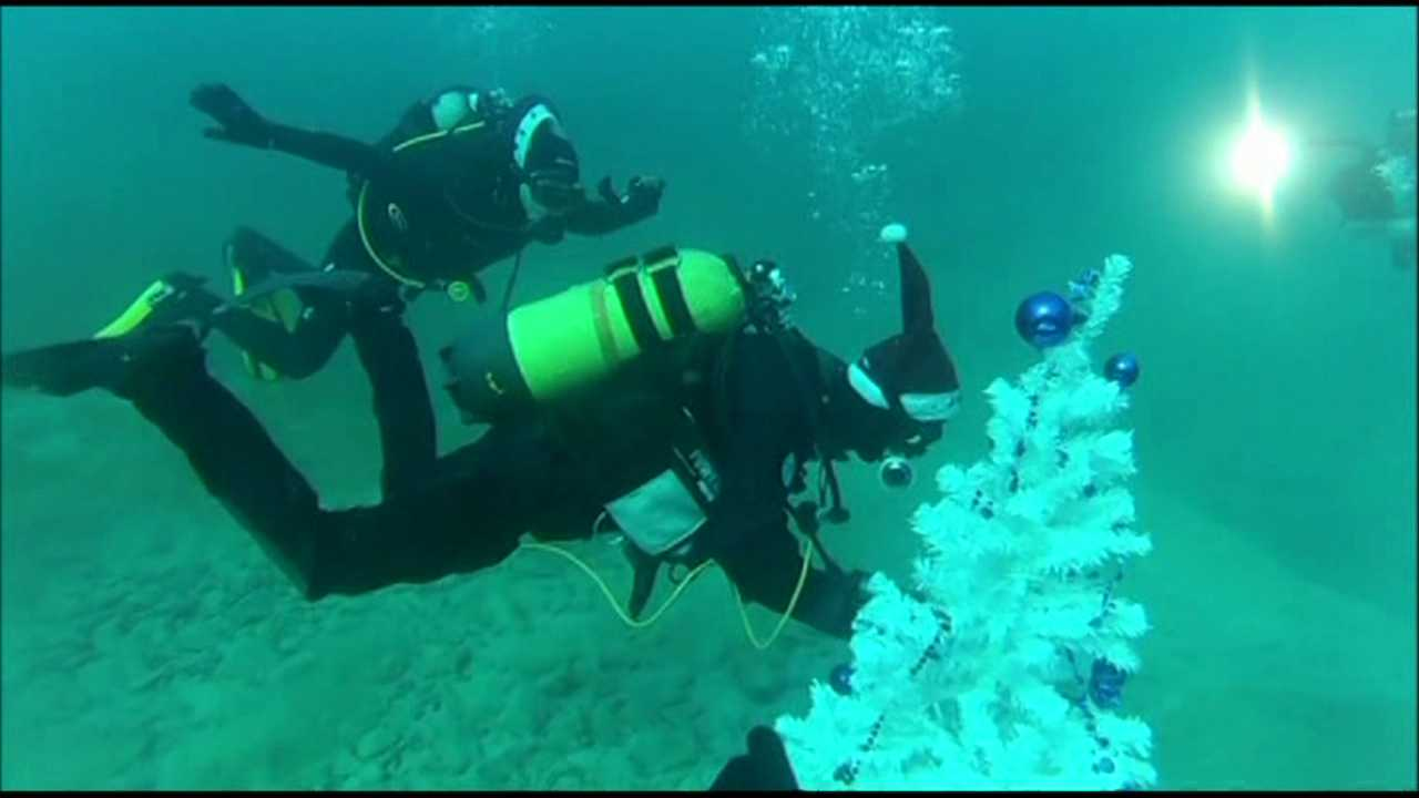 Decorating a Christmas tree underwater