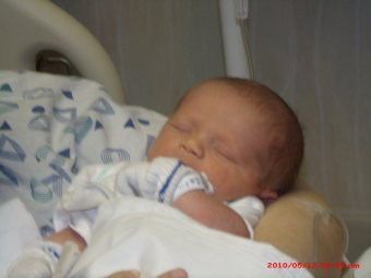 Khan, pictured at the hospital the day he was born.
