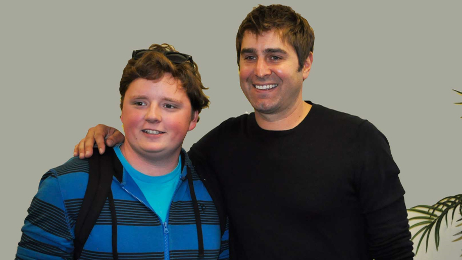 Trevor Long, DCCC student working toward an Associate in Science degree, poses with MythBusters star Tory Belleci.