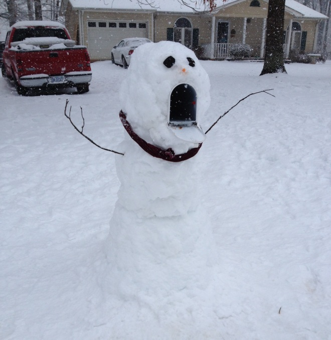We built our snowman around our mail box.. It was much harder than we thought it would be!