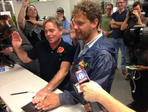 A couple swearing on the Bible after being issued the first same-sex marriage license in Guilford County. (WGHP-TV)