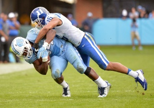 Jeremy Cash #16 of the Duke Blue Devils tackles Elijah Hood #34 of the North Carolina Tar Heels during their game at Kenan Stadium on November 7, 2015 in Chapel Hill, North Carolina. North Carolina won 66-31.  (Photo by Grant Halverson/Getty Images)