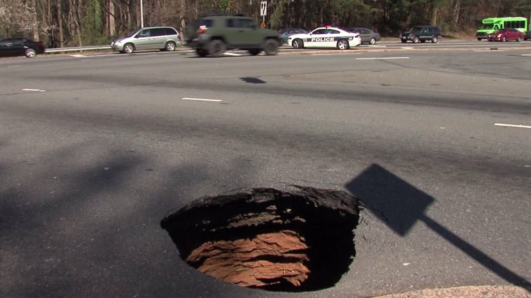 Sinkhole on Hanes Mall Boulevard at Silas Creek Parkway. (David Weatherly/WGHP)