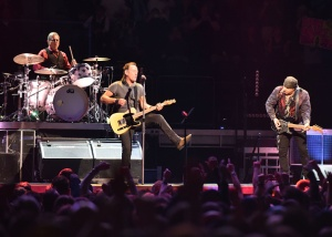 DENVER, COLORADO - MARCH 31: Musicians Max Weinberg, Bruce Springsteen and Stevie Van Zandt perform at Pepsi Center on March 31, 2016 in Denver, Colorado. (Photo by Allison Farden/Getty Images)