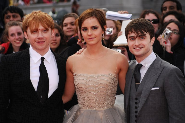Rupert Grint, Emma Watson and Daniel Radcliffe attend the World Premiere of Harry Potter and The Deathly Hallows - Part 2 at Trafalgar Square on July 7, 2011, in London, England. (Photo by Ian Gavan/Getty Images)