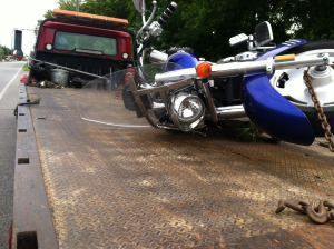 The motorcycle hit Sunday in Gibson County. The passengers were airlifted to a hospital in Memphis.