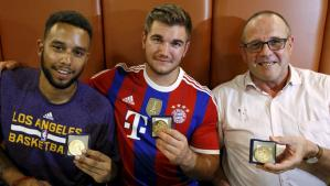 Anthony Sadler, from Pittsburg, California, Aleck Sharlatos from Roseburg, Oregon, and Chris Norman, a British man living in France (L-R), three men who helped to disarm an attacker on a train from Amsterdam to France, pose with medals they received for their bravery at a restaurant in Arras, France August 21, 2015. A machine gun-toting attacker wounded three people on a high-speed train in France on Friday before being overpowered by passengers who included an American soldier. The wounded were the soldier, French actor Jean-Hugues Anglade, and a Briton. Local media reported that U.S. Marines were among those who brought down the gunman. Officials said the attacker was arrested after the shooting when the Amsterdam to Paris train stopped at Arras station in northern France. REUTERS/Pascal Rossignol TPX IMAGES OF THE DAY