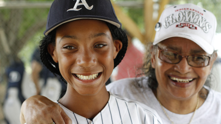 """Mamie """"Peanut"""" Johnson, right, the only female pitcher in the Negro Leagues, meets Monarchs only girl teammate and standout pitcher, Mo'ne Davis, 11. As a tribute to Jackie Robinson and the Negro Leagues, the Anderson Monarchs, an inner city, 11 year-old all black baseball team from South Philadelphia, will board an authentic 1947 Flxible Clipper touring bus, and embark on a 22-day, 4000-mile journey – """"barnstorming"""" their way across the country – all the way to the Negro Leagues Baseball Museum in Kansas City, arriving during the 2012 Major League Baseball All Star Game festivities. Along the way, The Monarchs will play games against local youth teams, meet surviving players from the Negro Leagues, visit historic sites - such as Jackie Robinson's grave site in Brooklyn, Wrigley Field, the Field of Dreams in Iowa, the Negro Leagues Baseball Museum, the Louisville Slugger Museum, the three remaining stadiums in the country which Negro League teams called home, and the National Baseball Hall of Fame in Cooperstown, NY. The young Monarchs will experience, first-hand, what life on the road was like for Jackie and the Negro League players. They'll be kids in a time capsule traveling back through time. They won't just be reading about history, they'll be living it. (CNN)"""