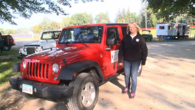Paula Brown stands by her Jeep Wranler as she talks about this weekend's Jeep show in Nevada.