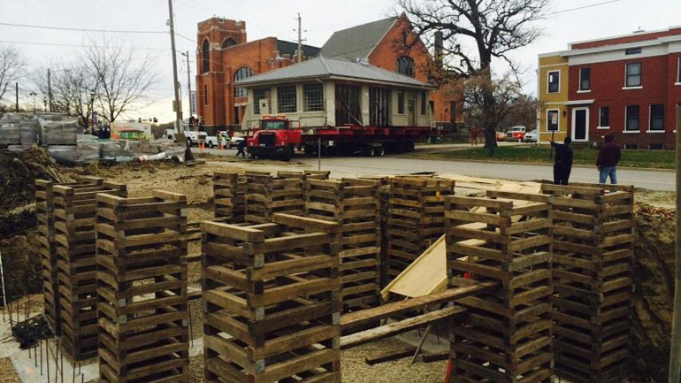 The historic Filling Station moves to its new home on 19th Street, after four years of sitting in the Kathedral Church parking lot (WHO-HD/Reid Chandler)