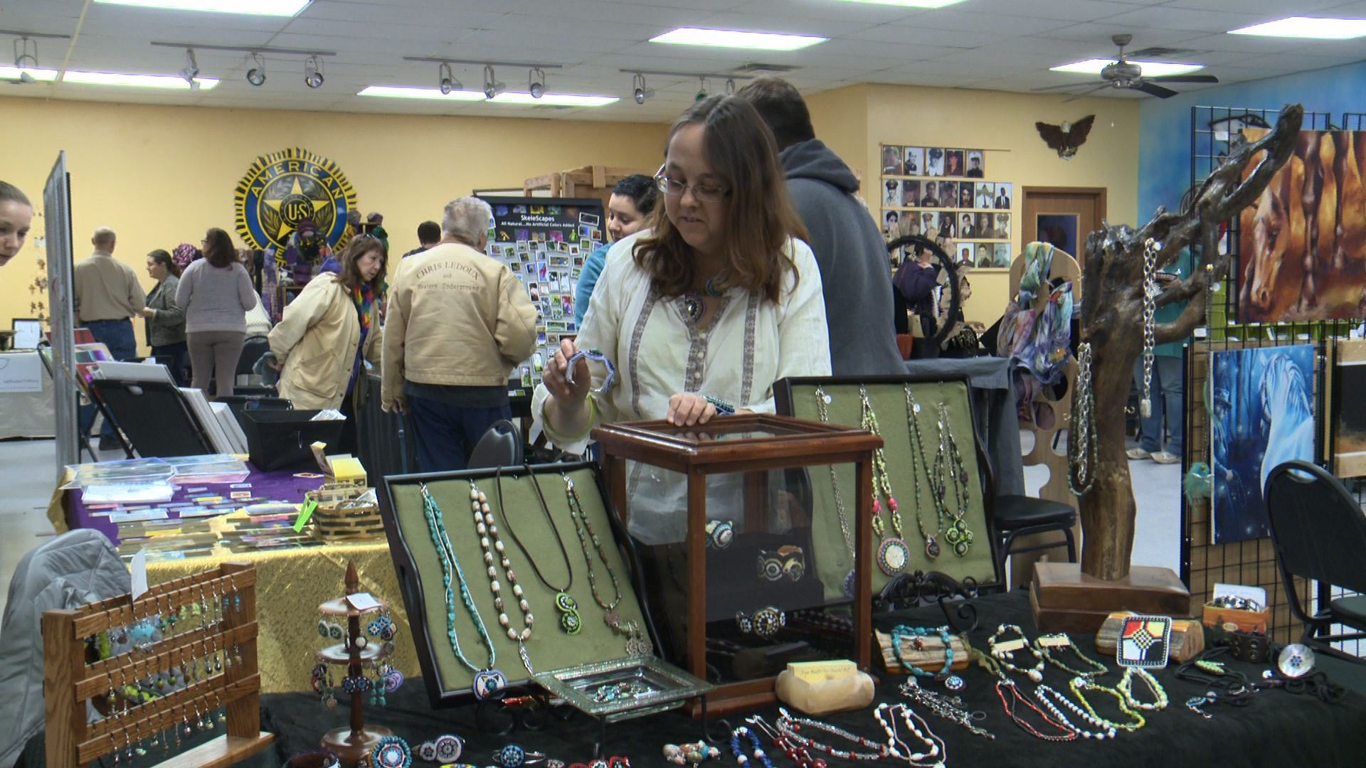 Betsy Hemping of Mitchellville displays Native American art at the Small Business Sunday in Des Moines. (Roger Riley photo)