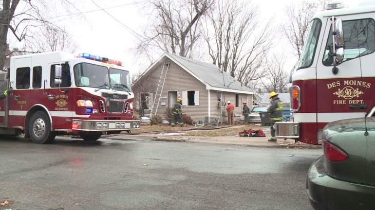 Firefighters on the scene of a house fire at  3117 Columbia Street in Des Moines on Saturday, December 20, 2014. (WHO-HD)