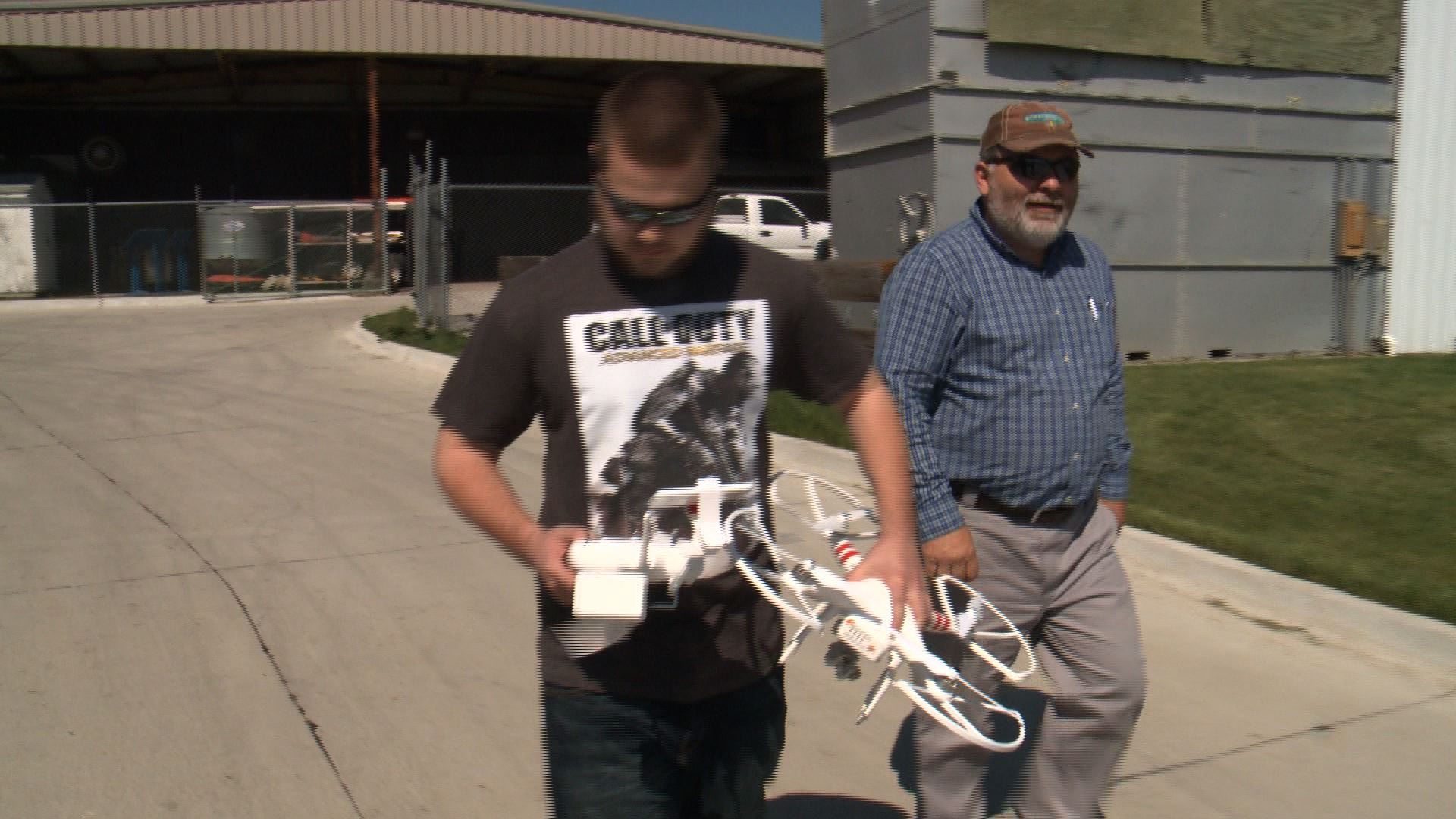 9th grader Adam Coussens and Instructor Kevin Cooper take out the FFA Drone (Roger Riley WHO-HD )