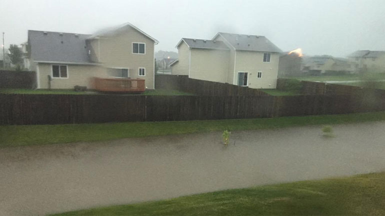 Flash flooding in Ankeny during the morning hours of Monday, July 6, 2015. (NICK ROBERTSON/WHO-HD)