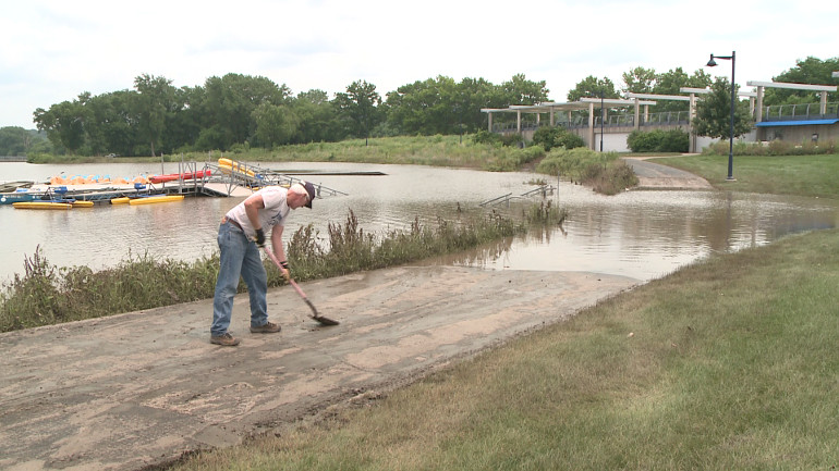 Volunteer helps clean up trail at Gray's Lake Park following flooding. (WHO-HD)