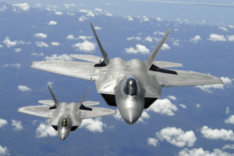 Two U.S. Air Force F-22 Raptor aircraft fly in trail behind a KC-135R Stratotanker aircraft after inflight refueling during a training mission off the coast of Florida on April 2, 2007. The Raptors are operating from Tyndall Air Force Base, Florida.