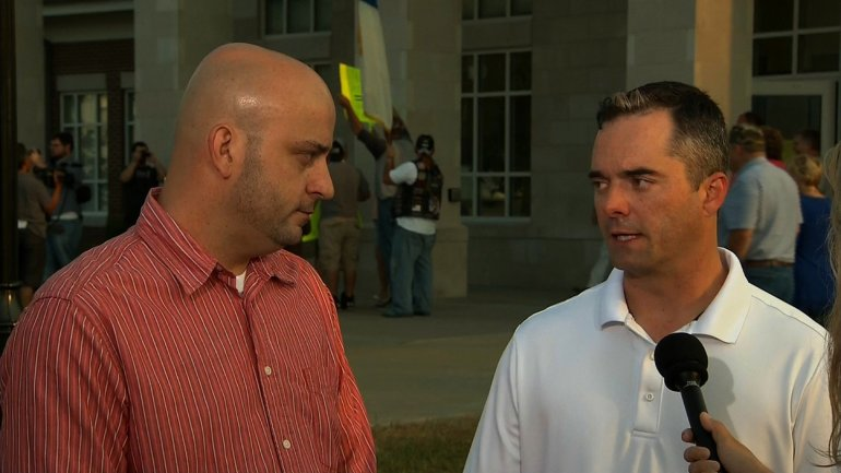 """William Smith Jr. and James """"Jim"""" Yates were the first couple to receive their same-sex marriage license from a deputy clerk in Rowan County, Kentucky. The license was issued one day after clerk Kim Davis was remanded into custody for failing to issue licenses following a Supreme Court order."""