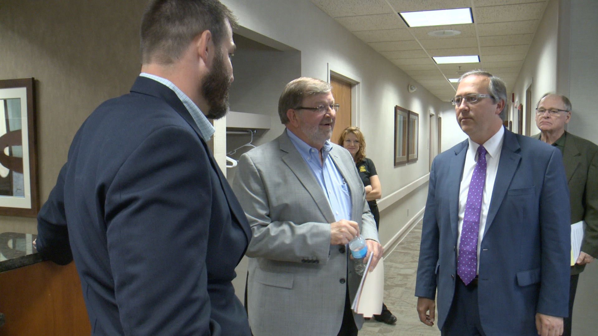 Gary Cheney of American Prosthetics and Orthotics chats with Congressman David Young in Clive Thursday. (Roger Riley WHO-HD)