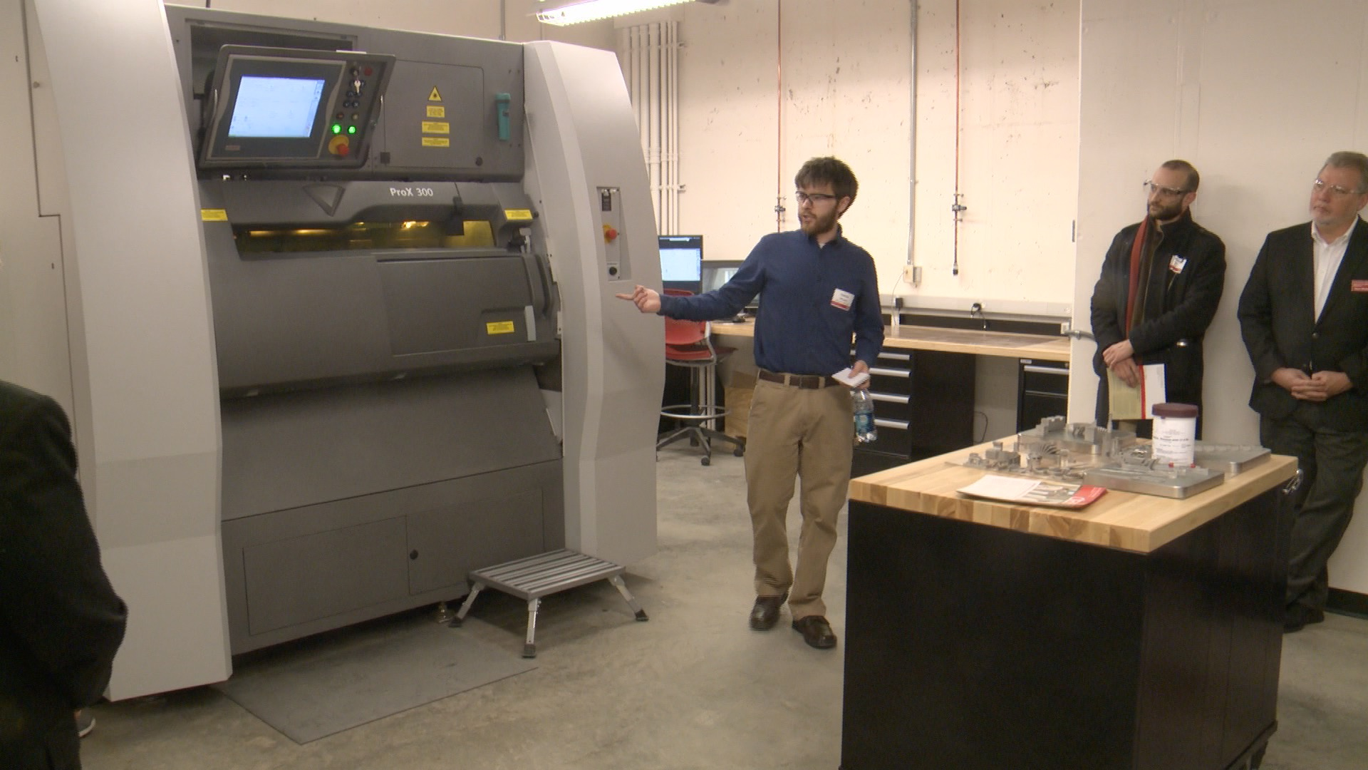 ISU Grad Student Dakota Morgan demonstrates the new Laser metal printer. (Roger Riley WHO-HD)