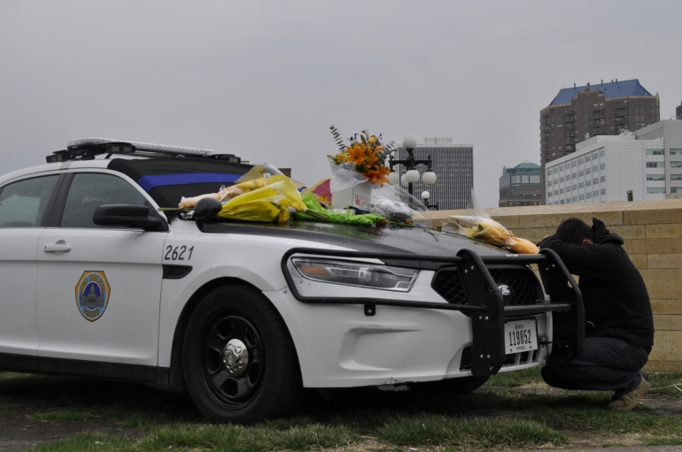 Flowers being left on a patrol vehicle to honor two Des Moines Police Officers killed in a crash on Saturday, March 26, 2016. (Alex Payne/WHO-HD)