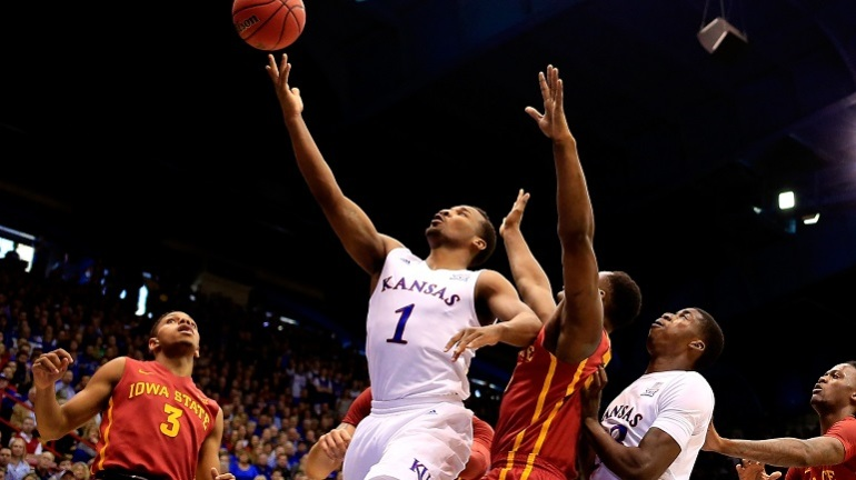 Wayne Selden Jr. #1 of the Kansas Jayhawks scores on a fast break during the game against the Iowa State Cyclones at Allen Fieldhouse on March 5, 2016 in Lawrence, Kansas. (Photo by Jamie Squire/Getty Images)