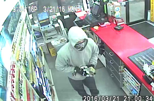 Security images from Monday robbery at Git-N-Go located at 4224 Northwest 2nd Street.