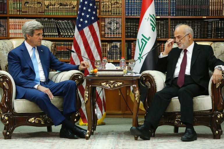 Iraq's Foreign Minister Ibrahim al-Jaafari (R) receives US Secretary of State John Kerry in the library at the foreign minister's villa in Baghdad on April 8, 2016.  Kerry visited Baghdad to back Iraq's government as it battles jihadists, struggles with a financial crisis and attempts to carry out reforms. / AFP / POOL / JONATHAN ERNST        (Photo credit should read JONATHAN ERNST/AFP/Getty Images)
