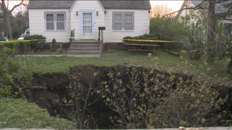 Sinkhole in south side yard. (WHO-HD)