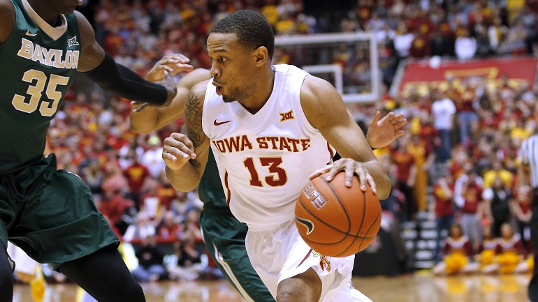 AMES, IA - FEBRUARY 25: Bryce Dejean-Jones #13 of the Iowa State Cyclones drives the ball against Johnathan Motley #35 of the Baylor Bears in the first half of play at Hilton Coliseum on February 25, 2015 in Ames, Iowa. (Photo by David Purdy/Getty Images)