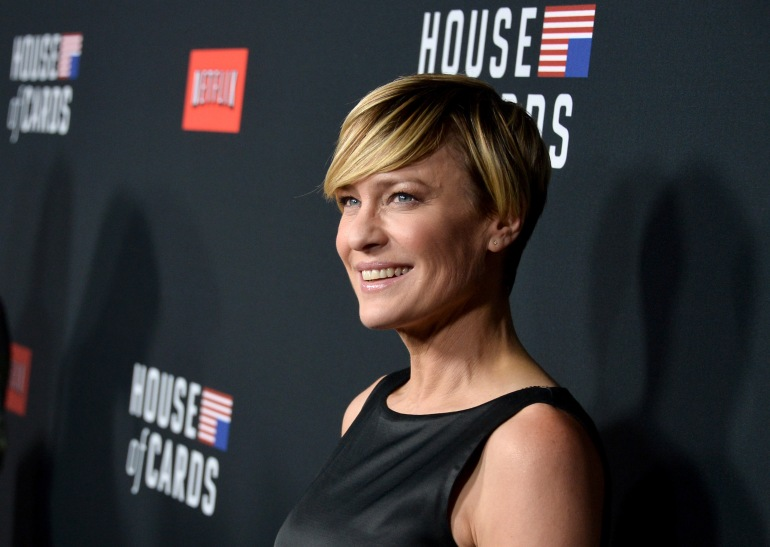 """LOS ANGELES, CA - FEBRUARY 13:  Actress Robin Wright arrives at the special screening of Netflix's """"House of Cards"""" Season 2 at the Directors Guild Of America on February 13, 2014 in Los Angeles, California.  (Photo by Kevin Winter/Getty Images)"""
