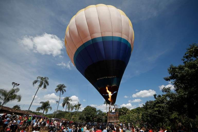 CORUMBA DE GOIAS, BRAZIL - MAY 04: The Olympic Torch is taken up in a hot air balloon during Day 2 of the Olympic Flame torch relay on May 4, 2016 in Corumba de Goias, Brazil. The Olympic torch will pass through 329 cities from all states from the north to the south of Brazil, until arriving in Rio de Janeiro on August 5, to lit the cauldron.