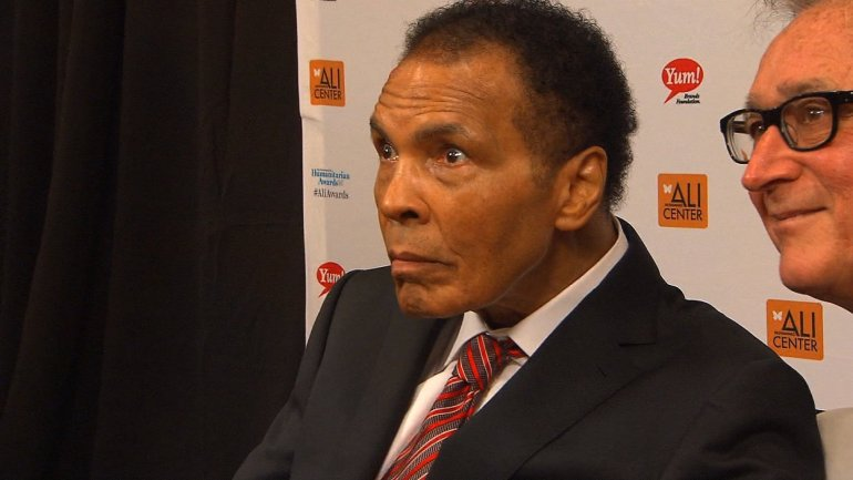 File- Appearing very frail, boxing legend Muhammad Ali made a rare public appearance Thursday, October 3, 2013 at an event in his hometown of Louisville, Kentucky to pay homage to others for their humanitarian work.
