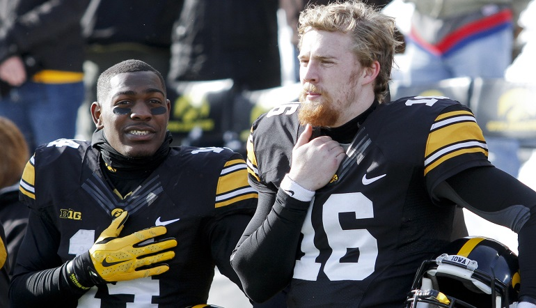 IOWA CITY, IA - NOVEMBER 21: Defensive back Desmond King #14 and quarterback C.J. Beathard #16 of the Iowa Hawkeyes stand before the match-up against the Purdue Boilermakers on November 21, 2015 at Kinnick Stadium, in Iowa City, Iowa. (Photo by Matthew Holst/Getty Images)