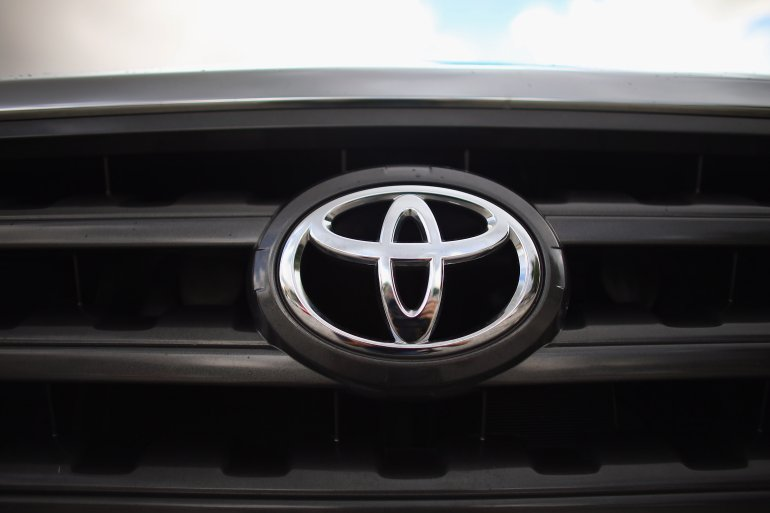 MIAMI, FL - OCTOBER 10: The Toyota emblem is seen on the grill of a 2008 Toyota Highlander as it sits on the Affordable Motors sales lot on October 10, 2012 in Miami, Florida. The 2008 Highlander is one of 7.43 million that Toyota says it is recalling globally for a faulty power-window switch that may stop working or catch fire in more than a dozen models that include the Yaris, RAV4, Tundra, Camry, Camry Hybrid, Scion xD, Scion xA, Sequoia, Highlander, Highlander Hybrid, Corolla and the Matrix produced from 2005 through 2010. (Photo by Joe Raedle/Getty Images)