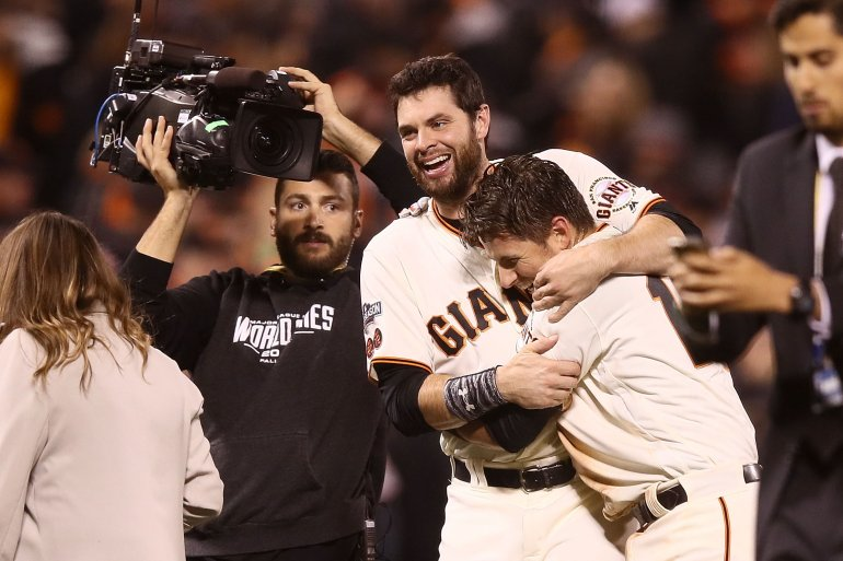 SAN FRANCISCO, CA - OCTOBER 10: Joe Panik #12 of the San Francisco Giants celebrates with Brandon Belt #9 after he doubled home the game winning run in the thirteenth inning against the Chicago Cubs during Game Three of their National League Division Series against the Chicago Cubs at AT&T Park on October 10, 2016 in San Francisco, California. (Photo by Ezra Shaw/Getty Images)
