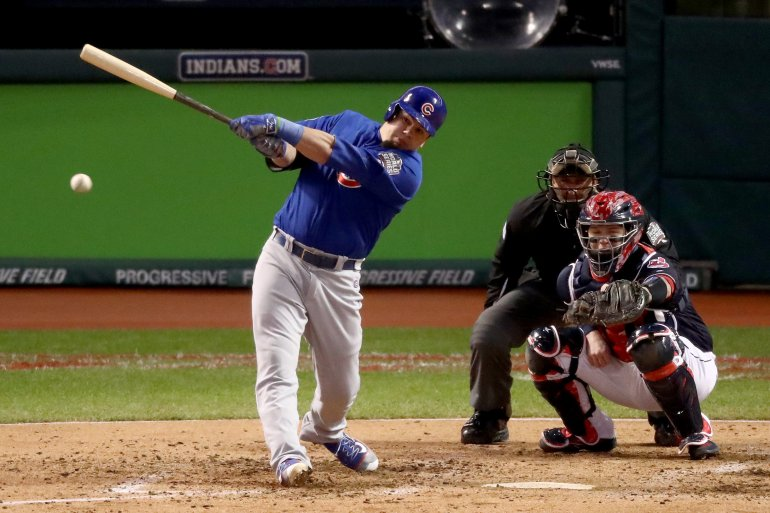 CLEVELAND, OH - OCTOBER 26:  Kyle Schwarber #12 of the Chicago Cubs hits an RBI single to score Anthony Rizzo #44 (not pictured) during the third inning against the Cleveland Indians in Game Two of the 2016 World Series at Progressive Field on October 26, 2016 in Cleveland, Ohio.  (Photo by Elsa/Getty Images)