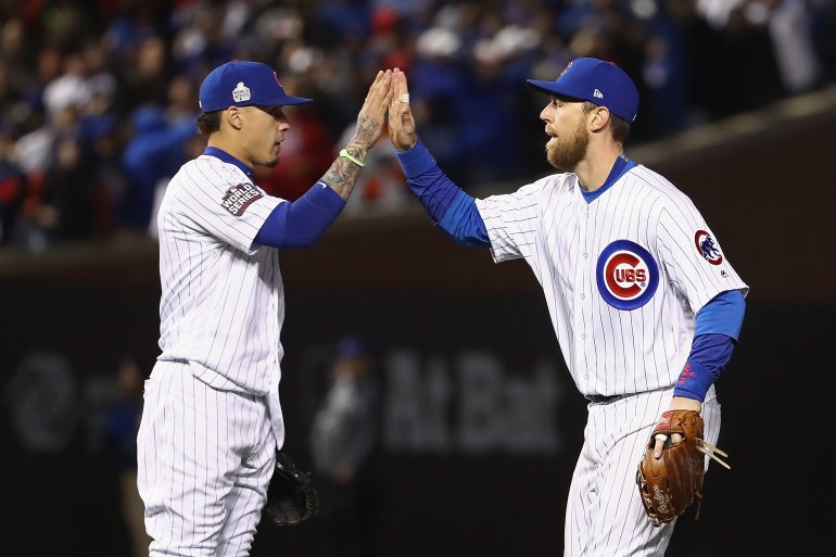 CHICAGO, IL - OCTOBER 30: Javier Baez #9 (L) and Ben Zobrist #18 of the Chicago Cubs celebrate after beating the Cleveland Indians 3-2 in Game Five of the 2016 World Series at Wrigley Field on October 30, 2016 in Chicago, Illinois. (Photo by Elsa/Getty Images)