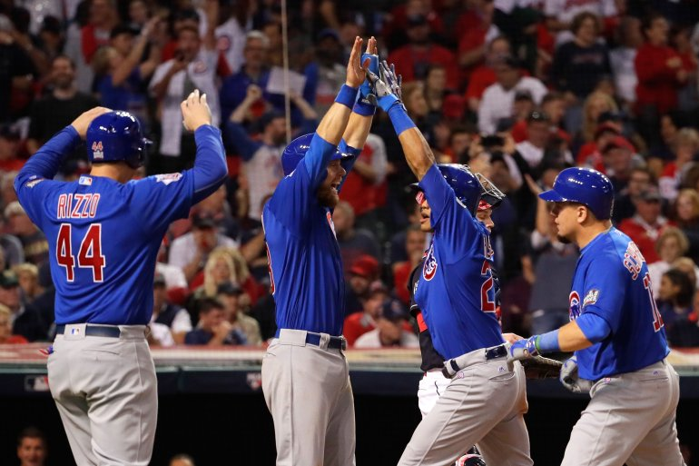 CLEVELAND, OH - NOVEMBER 01:  Addison Russell #27 of the Chicago Cubs celebrates with Anthony Rizzo #44, Ben Zobrist #18 and Kyle Schwarber #12 after hitting a grand slam home run during the third inning against the Cleveland Indians in Game Six of the 2016 World Series at Progressive Field on November 1, 2016 in Cleveland, Ohio.  (Photo by Jamie Squire/Getty Images)