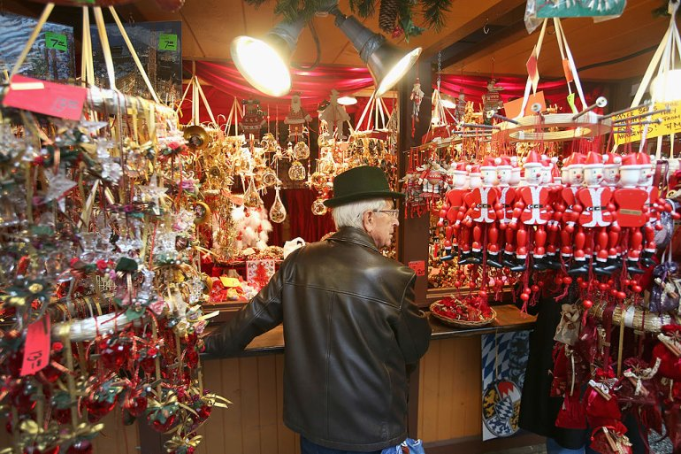 CHICAGO, IL - DECEMBER 04: Wayne Wietbrock, a retired farmer from Lowell, Indiana shops for Christmas ornaments at Christkindlmarket Chicago on December 4, 2013 in Chicago, Illinois. Christkindlmarket Chicago is a German-themed outdoor market open during the Christmas shopping season in Daley Plaza in the Chicago Loop. Vendors sell gifts, crafts, ornaments and traditional German food at the market. (Photo by Scott Olson/Getty Images)
