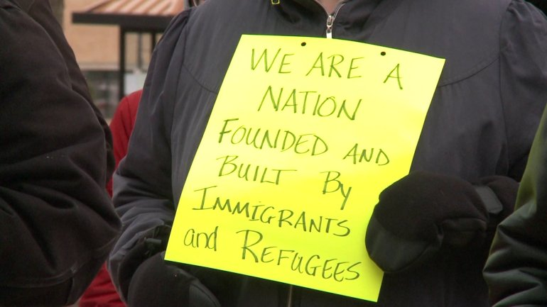 A group gathered in Dubuque on Saturday to protest the immigrant ban. (WHO-HD)