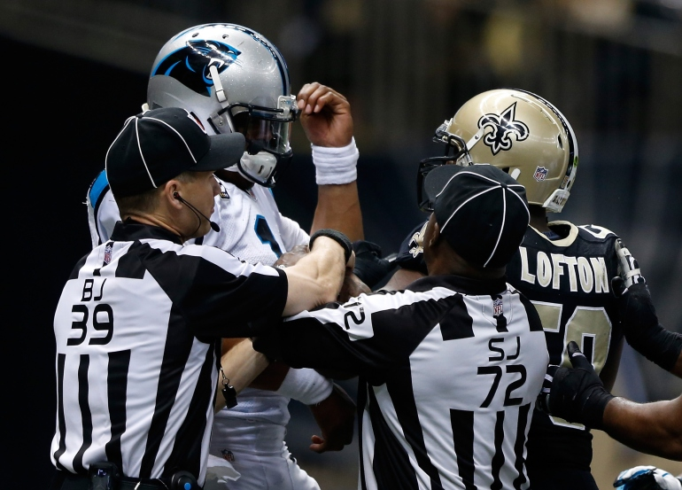Cam Newton #1 of the Carolina Panthers and  Curtis Lofton #50 of the New Orleans Saints get into a fight after a touchdown during the first quarter at Mercedes-Benz Superdome on December 7, 2014 in New Orleans, Louisiana.  (Sean Gardner/Getty Images)