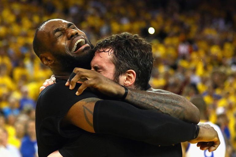 LeBron James #23 and Kevin Love #0 of the Cleveland Cavaliers celebrate after defeating the Golden State Warriors 93-89 in Game 7 of the 2016 NBA Finals at ORACLE Arena on June 19, 2016 in Oakland, California. (Ezra Shaw/Getty Images)