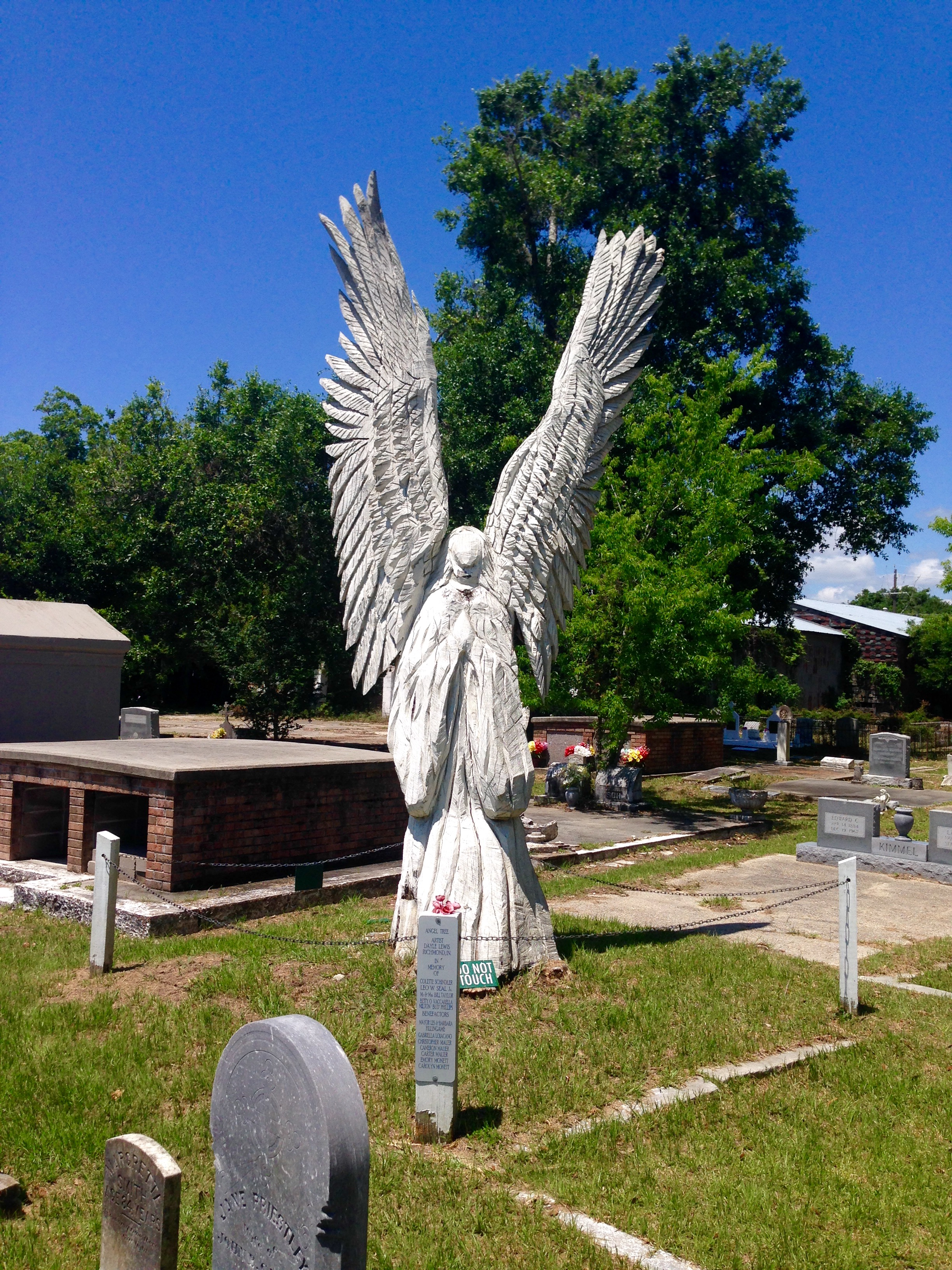 There are four angel trees in Bay St. Louis, all carved by chainsaw artist Dale Lewis. (Stephanie Oswald/WGNO)